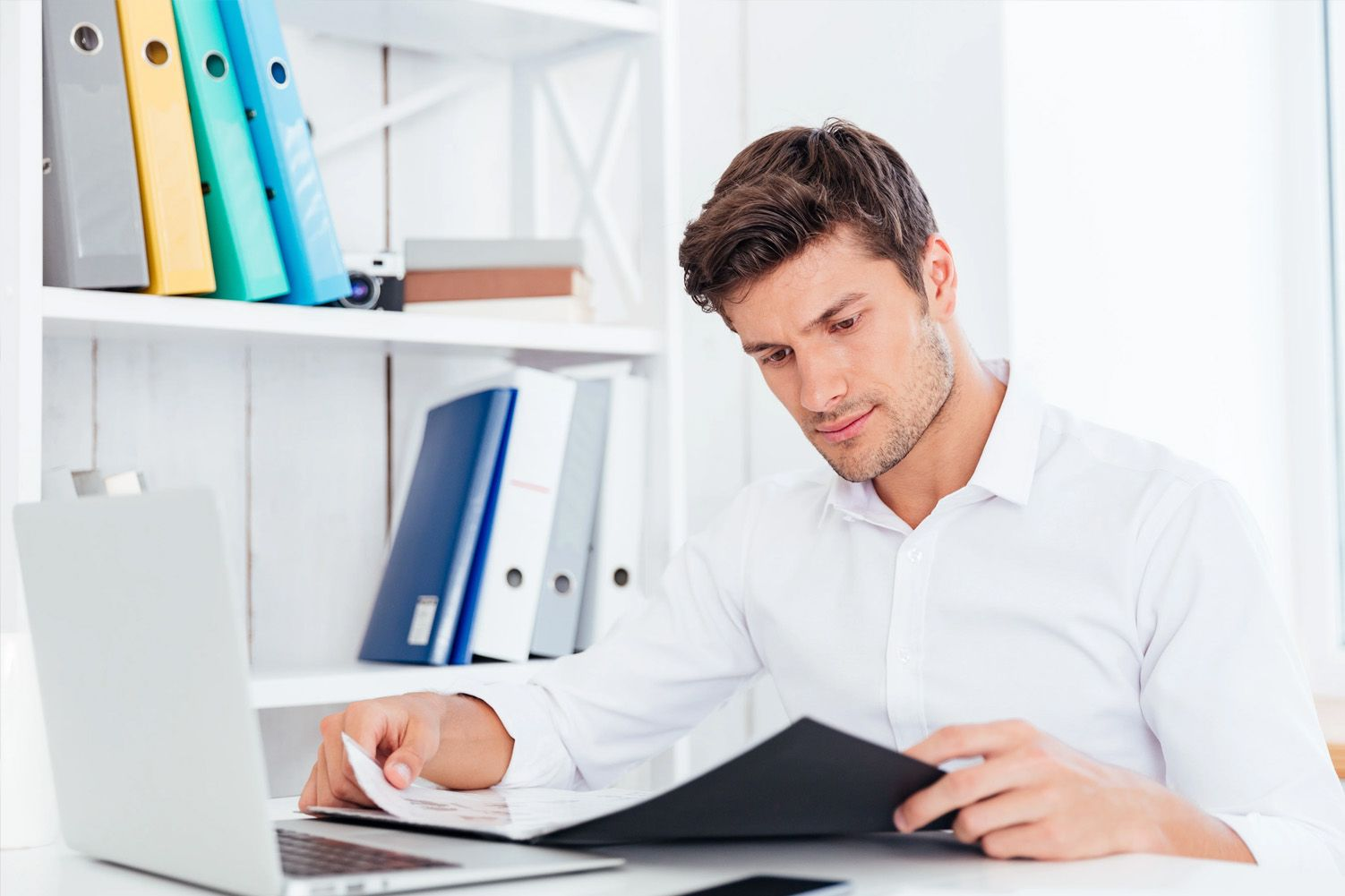 man in office looking at documents