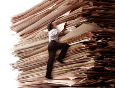 man climbing stack of paperwork