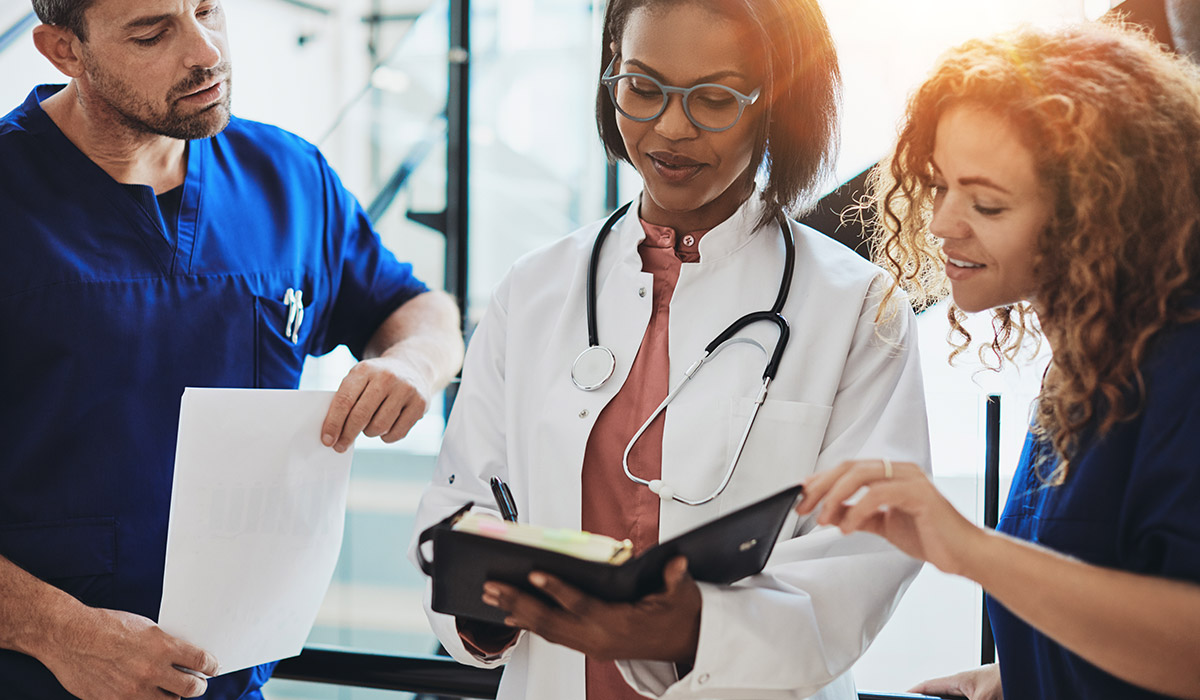 doctors-working-together-and-looking-at-notepad